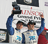 Scott Pruett, left, and Memo Rojas celebrate after winning the Gainsco Grand Prix of Miami Grand Am Rolex Seires sports car race at Homestead-Miami Speedway in Homestead, FL in March of 2008. (Photo by Brian Cleary/www.bcpix.com)
