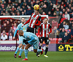 John Lundstram of Sheffield Utd  wins the aerial ball during the Championship match at Bramall Lane Stadium, Sheffield. Picture date 26th December 2017. Picture credit should read: Simon Bellis/Sportimage