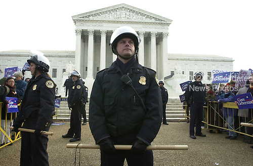United States Supreme Court police keep the peace in front of the Court in Washington, DC on December 11, 2000.<br /> Credit: Ron Sachs - CNP