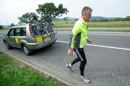29 SEP 2013 - NEWINGTON, GBR - Rod Elder sets out again on the 77 mile run of the Enduroman 2013 Lands End to London to Dover ultra triathlon after stopping  near Newington in Kent, Great Britain for a cup of soup (PHOTO COPYRIGHT © 2013 NIGEL FARROW, ALL RIGHTS RESERVED)