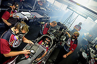 Sept. 16, 2012; Concord, NC, USA: NHRA top fuel dragster driver Shawn Langdon is surrounded by crew members as he warms up his car in the pits during the O'Reilly Auto Parts Nationals at zMax Dragway. Mandatory Credit: Mark J. Rebilas-