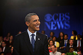 United States President Barack Obama laughs during a pause in the taping of a CBS News Town Hall Meeting on the Economy at the Newseum in Washington, DC, USA, on 11 May, 2011..Credit: Jim LoScalzo / Pool via CNP