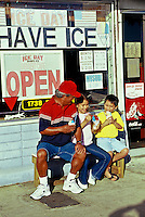 Grandpa and two boys eating shave ice on Oahu's north shore