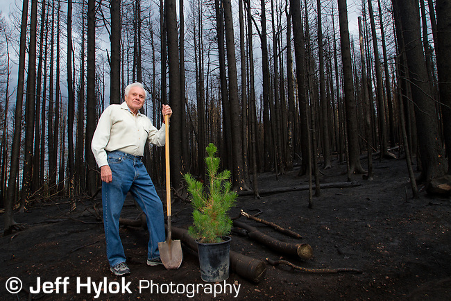 Milt Gillespie, 50 year Pajarito Mountain volunteer, standing in front of his namesake ski run. Las Conchas fire + 7 days.