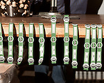 June 18, 2013. Chapel Hill, North Carolina<br />   Gin bottle labels, showing the product's organic designation, await bottled liquor.<br />  TOPO, Top of the Hill Distillery, the brainchild of owner Scott Maitland and Spirit Guide Esteban McMahan, is located in the old N&O Building on Franklin Street. Making gin, vodka and American whiskey from locally sourced wheat, they are one of the few distilleries bringing  organic liquor to ABC shelves around the state.