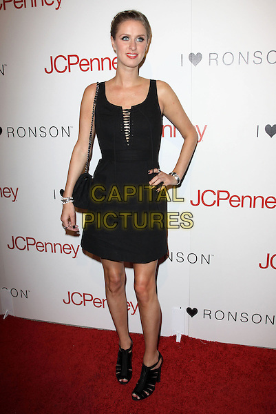 NICKY HILTON .Charlotte Ronson and JCPenney Spring Cocktail Jam held At The The Milk Studio, Los Angeles, California, USA, 4th May 2010..full length black dress sleeveless bag hand on hip open peep toe shoes sandals silver bracelet ring .CAP/ADM/KB.©Kevan Brooks/AdMedia/Capital Pictures.