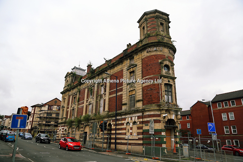 Pictured: Exterior view of The Palace Theatre. Sunday 16 July 2017<br />Re: A team of highly trained Levitators harness their psychic forces to raise The Palace Theatre on the High Street in Swansea, south Wales, as part of the Troublemakers Festival.<br />The theatre was built in 1888 as a traditional music hall, named originally the 'Pavilion'. During its lifetime, the building has been used as a bingo hall as well as a gay nightclub.<br />The Grade II Listed building is one of just two purpose-built music halls left standing in the whole of the UK.<br />In the early years of the 20th century stars like Charlie Chaplin, Lilly Langtry, Marie Lloyd and Dan Leno filled the venue.<br />Sir Anthony Hopkins made his first professional stage appearance there in 1960 with Swansea Little Theatre's production of 'Have A Cigarette'.<br />Also in the early 1960s, Morecambe and Wise were booked. Ken Dodd was the last stand-up comedian to appear there before it became nightclub in the 1970s.<br />It was also the first place in Wales to show a silent picture and remained undamaged by the blitz that destroyed much of Swansea city centre during the Second World War.<br />Eventually the theatre was sold for £300,000 to a property company, but in 2010 it was still derelict and actor Edward Fox joined a campaign to have it restored.