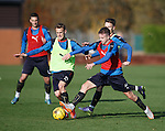 Dean Shiels and Andy Halliday go for it at training