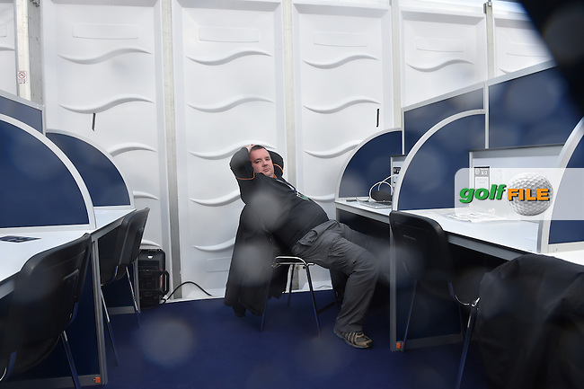 Golffile editor Fran Caffrey killing time in the media centre with suspension of play due to high winds and waterlogged course at the start of Friday's Round 2 of the 144th Open Championship, St Andrews Old Course, St Andrews, Fife, Scotland. 17/07/2015.<br /> Picture Eoin Clarke, www.golffile.ie