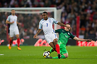 England's Raheem Sterling is fouled by Slovenia's Rajko Rotman <br /> <br /> Photographer Craig Mercer/CameraSport<br /> <br /> FIFA World Cup Qualifying - European Region - Group F - England v Solvenia - Thursday 5th October 2017 - Wembley Stadium - London<br /> <br /> World Copyright &copy; 2017 CameraSport. All rights reserved. 43 Linden Ave. Countesthorpe. Leicester. England. LE8 5PG - Tel: +44 (0) 116 277 4147 - admin@camerasport.com - www.camerasport.com