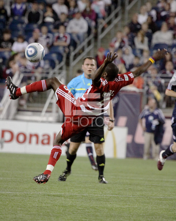 FC Dallas defender Jair Benitez(5) leaps to intercept a pass.  The New England Revolution drew FC Dallas 1-1, at Gillette Stadium on May 1, 2010