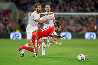 Gareth Bale of Wales falls under a challenge from Guram Kashia of Georgia during the FIFA World Cup Qualifier match between Wales and Georgia at the Cardiff City Stadium, Cardiff, Wales on 9 October 2016. Photo by Mark  Hawkins / PRiME Media Images.