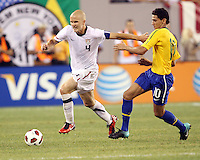 Michael Bradley #4 of the USA pushes away from Paulo Henrique Ganso #10 of Brazil during an international friendly matchl in Giants Stadium, on August 10 2010, in East Rutherford, New Jersey.Brazil won 2-0.