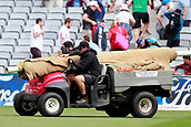 23rd March 2018, Eden Park, Auckland, New Zealand; International Test Cricket, New Zealand versus England, day 2;  Ground staff bring out the covers for a rain delay