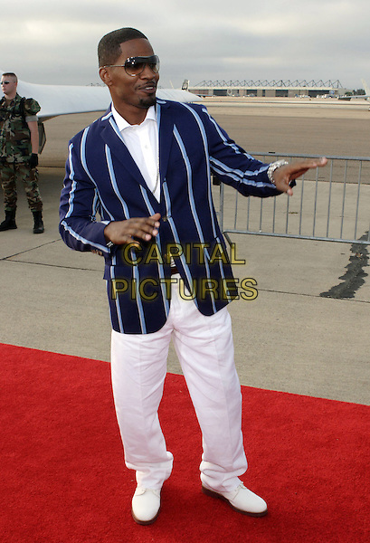 "JAMIE FOXX.World Premiere of Columbia Pictures ""Stealth"".July 17th, 2005.full length white trousers white shoes hand gesture sunglasses shades.www.capitalpictures.com.sales@capitalpictures.com.© Capital Pictures."