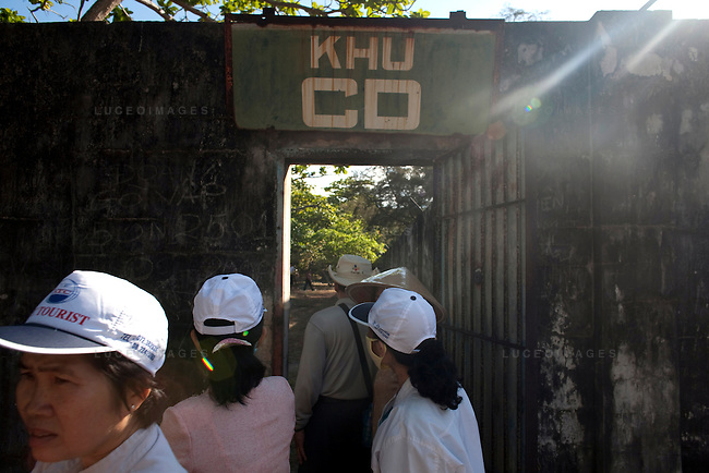 Tourists, including ex-prisoners, tour Phu Binh Camp prison on Con Son Island, part of the Con Dao Islands.The 16 mountainous islands and islets are situated about 143 miles southeast of Ho Chi Minh City in Vietnam, in the South China Sea. Eleven prisons were built on the island and are now open for tours.  Photo taken Wednesday, May 4, 2010...Kevin German / LUCEO For the New York Times