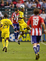 Chivas USA forward Giancarlo Maldonado (20) battles Columbus Crew defender Andy Iro (6) in the air. CD Chivas USA defeated the Columbus Crew 3-1 at Home Depot Center stadium in Carson, California on Saturday July 31, 2010.
