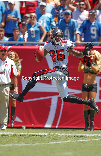 Tampa Bay Buccaneers defensive back Aqib Talib (25) celebrates his touchdown on an interception of Detroit Lions quarterback Matthew Stafford (9). The Lions defeated the Buccaneers 27-20 in the first game of the regular NFL season on Sunday, Sept. 11, 2011, at Raymond James Stadium in Tampa, Florida. (AP Photo/Margaret Bowles)