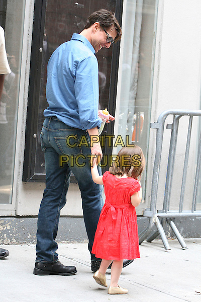 TOM CRUISE, SURI CRUISE .The Cruise family spotted in Greenwich Village, New York City, NY, USA, .August 15, 2008..full length father daughter blue shirt sunglasses child red dress bottle gold mary jane shoes bob jeans holding hands back rear behind smiling walking.CAP/LNC/DER.©LNC/Capital Pictures