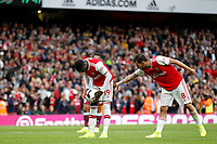 Nicolas Pépé of Arsenal has his bum patted by Dani Ceballos during the Premier League match between Arsenal and Aston Villa at the Emirates Stadium, London, England on 22 September 2019. Photo by Carlton Myrie / PRiME Media Images.