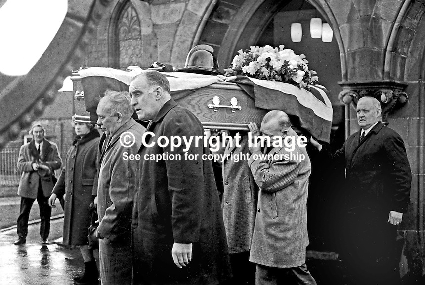Funeral of 23 year old Fireman Brian Douglas who was shot dead by the UDA/UFF whilst attending a blaze near the junction of Sandy Row and Lisburn Road in South Belfast. The killing was one of four during a one day general strike on 7th February 1973. Family members &amp; personal friends  carry his coffin with his fireman's helmet on top from the church. The funeral was attended by firemen colleagues from all over N Ireland. 197302100085b.<br />