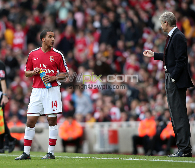 PICTURE BY JEREMY RATA/SWPIX.COM. Barclays Premier League 2008/9 - Arsenal v Blackburn Rovers, Emirates Stadium, London, England. 14th March 2009. Arsenal's Theo Walcott is coached by Arsne Wenger during a break in the game..Copyright - Simon Wilkinson - 07811267706
