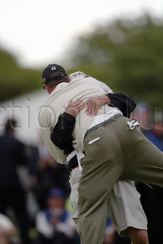 18 July 2004: American golfer TODD HAMILTON (USA) celebrates with his caddie RON LEVIN on the 18th after winning the play-off over Ernie Els in The Open Championship, played at Royal Troon, Scotland. Hamilton and Els tied on 274 Photo: Glyn Kirk/Action Plus...golf golfers 040718 winning green joy celebrate celebration celebrations british