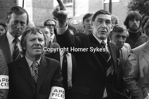 Grunwick Asian women s film processing factory strike,  industrial dispute. 1977. Mick McGahey Vice President of the National Union of Mineworkers and President of the NUM's Scottish Area. Eric Clarke, The Secretary of the NUM's Scottish Area later Labour MP for Midlothian (1992-2001) ( in stripped tie- far left of image.