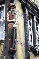 merchant figure carved in wood rue des marchands colmar alsace france