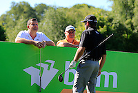 Anthony Wall (ENG) and Stephen Dodd (WAL) peep over the hoarding to watch Graham McDowell (NIR) tee off during Wednesday's Pro-Am of the 2014 Irish Open held at Fota Island Resort, Cork, Ireland. 18th June 2014.<br /> Picture: Eoin Clarke www.golffile.ie