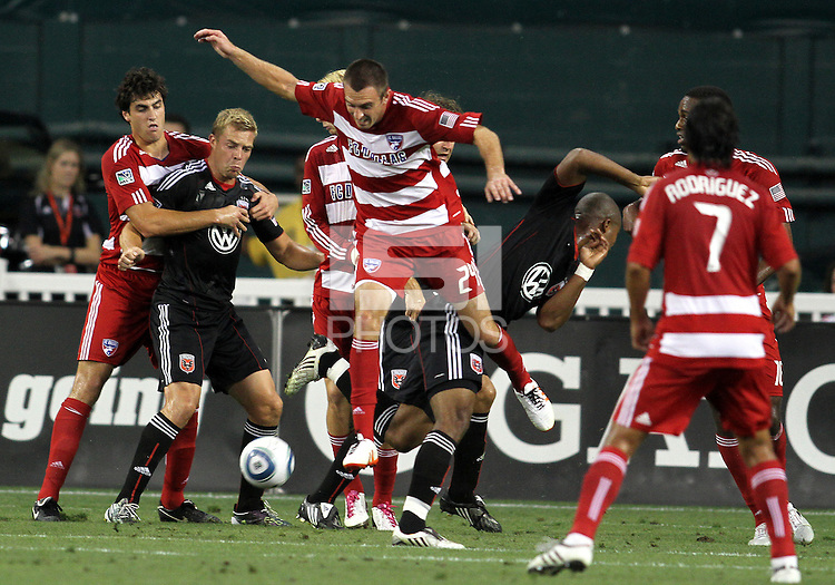 Daniel Allsopp #9 of D.C. United is held by George John #14 of FC Dallas while Eric Alexander #24 gets the ball during an MLS match at RFK Stadium in Washington D.C. on August 14 2010. Dallas won 3-1.