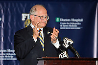 4 May 2012:  FIU President Mark Rosenberg applauds his athletic program at a press conference during which the FIU Golden Panthers, currently a member of the Sun Belt Conference, formally announced their acceptance of an invitation to join Conference USA for all sports starting July 1, 2013, at the FIU Stadium Club in Miami, Florida.