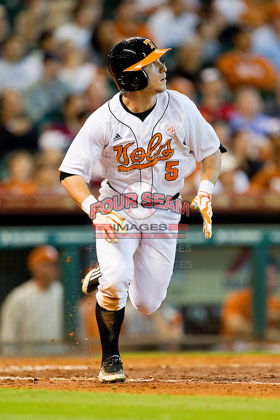 Chris Pierce #5 of the Tennessee Volunteers watches the flight of the baseball as he runs down the first base line against the Texas Longhorns at Minute Maid Park on March 3, 2012 in Houston, Texas.  The Volunteers defeated the Longhorns 5-4.  (Brian Westerholt/Four Seam Images)