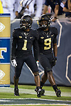 Tabari Hines (1) of the Wake Forest Demon Deacons celebrates with teammate Chuck Wade Jr. (9) after scoring a touchdown during during first half action against the Georgia Tech Yellow Jackets at Bobby Dodd Stadium on October 21, 2017 in Atlanta, Georgia.  The Yellow Jackets defeated the Demon Deacons 38-24. (Brian Westerholt/Sports On Film)