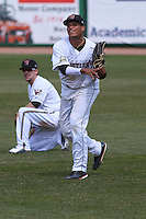Wisconsin Timber Rattlers outfielder Elvis Rubio (17) throws to the infield during a game against the Quad Cities River Bandits on May 2nd, 2015 at Fox Cities Stadium in Appleton, Wisconsin.  Quad Cities defeated Wisconsin 5-2.  (Brad Krause/Four Seam Images)
