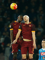 AS Roma's Antonio Rudiger   and  AS Roma's Edin Dzeko  jump for the ball during the  italian serie a soccer match,between SSC Napoli and AS Roma       at  the San  Paolo   stadium in Naples  Italy ,December 13, 2015