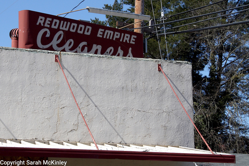 The sign for the, now abandoned, Redwood Empire Cleaners on West Mendocino Avenue in Willits in Mendocino County in Northern California
