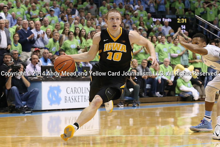 03 December 2014: Iowa's Mike Gesell. The University of North Carolina Tar Heels played the University of Iowa Hawkeyes in an NCAA Division I Men's basketball game at the Dean E. Smith Center in Chapel Hill, North Carolina. Iowa won the game 60-55.