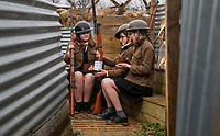 BNPS.co.uk (01202 558833)<br /> Pic: PhilYeomans/BNPS<br /> <br /> l-r Martina, Jake and Mae - students of Garth Hill College in Bracknell get used to life in the trenches.<br /> <br /> Class War - A school has turned part of its playground into a replica First World War trench system that makes an fascinating and poignant living history classroom.<br /> <br /> The scaled down trenches allows pupils to get an authentic, hands-on lesson on what life and conditions were like for the unfortunate soldiers who served on the Western Front. <br /> <br /> As well as being given educational talks, students also get muddy taking part in re-enactment demonstrations in the trenches. <br /> <br /> The attention to detail includes replica rifles, bayonets, shell casings and even models of the ever present rats.<br /> <br /> The outdoor classroom is the first of its kind in the country and schools from miles around are booking up visits for their students to experience the real feel of the award winning movie 1917.