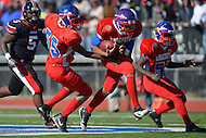 November 22, 2012  (Washington, DC)  Anacostia QB DeQuan Turner (1) runs with the ball, with Travis Reed (55) and Antonio Simpson (52) assisting, during the 2012 DCIAA Turkey Bowl. Dunbar defeated Anacostia 12-8.  (Photo by Don Baxter/Media Images International)