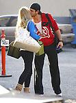 2-23-09.Denise Richards kissing Maksim Chmerkovskiy her dancing with the stars partner goodbye in los Angeles ca ...AbilityFilms@yahoo.com.805-427-3519.www.AbilityFilms.com.
