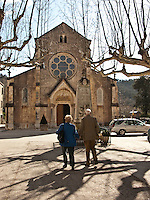 Visitors approach the village church in Collobrieres in the Provence region of Southern France.
