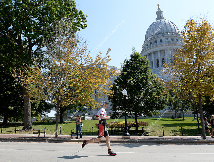 Athletes round the Capitol Square during the 2017 IRONMAN Wisconsin on Sunday, September 10 in Madison