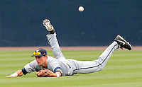 Virginia outfielder Brandon Downes (10) misses a diving catch in the fifth inning of an NCAA college baseball tournament super regional game against Maryland in Charlottesville, Va., Sunday, June 8, 2014. Virginia defeat Maryland 7-3. (AP Photo/Andrew Shurtleff)