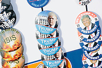 """An independent merchandise seller displayed pro-Trump campaign buttons, shirts, and hats, outside the venue after real estate mogul and Republican presidential candidate Donald Trump spoke at a rally at Exeter Town Hall in Exeter, New Hampshire, on Thurs., Feb. 4, 2016. Buttons had slogans such as """"Trump for President,"""" """"Hot Chicks for Trump,"""" and """"Hillary for Prison."""""""
