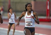 NWA Democrat-Gazette/BEN GOFF @NWABENGOFF<br /> Tiana Wilson of Arkansas runs in the women's 400 meter run Friday, April 12, 2019, at the John McDonnell Invitational at John McDonnell field in Fayetteville.