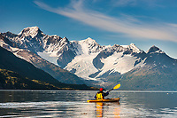 Kayakers paddle in Harriman Fjord, Chugach mountains, Chugach National Forest, Prince William Sound, southcentral, Alaska.