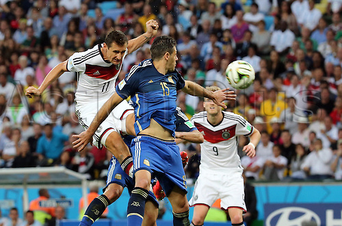 13.07.2014. Rio de Janeiro, Brazil. World Cup Final. Germany v Argentina. Klose jumps for the header against Demichelis