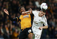 Angel Rangel of Swansea City and Chuba Akpom of Hull City during the Capital One Cup match between Hull City and Swansea City played at the Kingston Communications Stadium, Hull