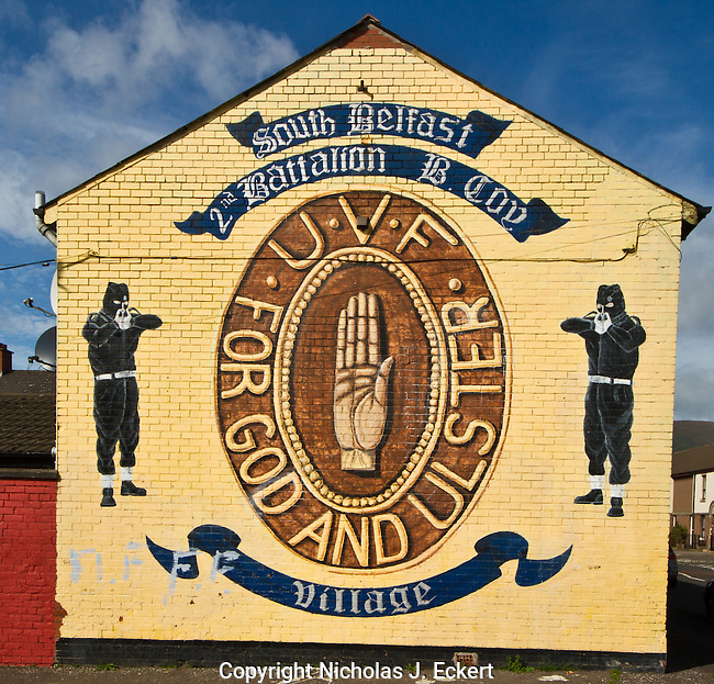 "This is a mural staking out the territory of a particular group of UVF men in the South Belfast neighborhood of the Village.  ""Ulster"" is the name Loyalists use to refer to the six counties that make up the Northern Ireland statelet.  In contrast, Republicans call it ""the North of Ireland,"" ""the North,"" ""the Six Counties,"" or ""the Black North."""